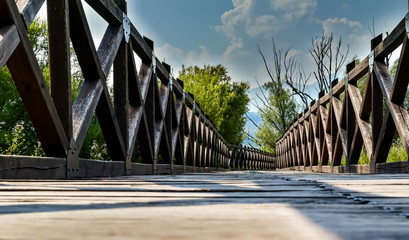 low angle view of wooden bridge in the Italian nature reserve Posta Fibreno
