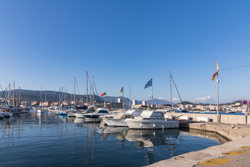 Boats and luxury yachts in Ajaccio harbor, Corsica, France.