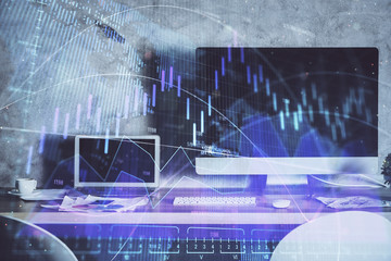 Financial graph colorful drawing and table with computer on background. Double exposure. Concept of...