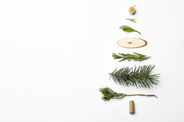 Fotobehang - Christmas tree made of natural materials on white background, top view