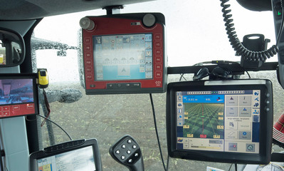 Tractor with GPS system for Planting potatoes. Agriculture. Farming Machines