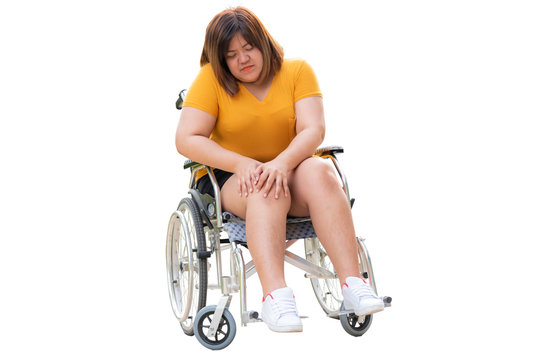 Asian fat woman are Patients sitting on a wheelchair She Have a knee pain Due to excessive weight and many complications From cholesterol, On white isolated backgrond to health care concept.