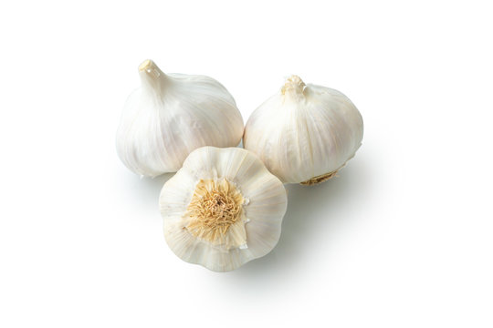 Raw garlic heads isolated on white background close-up