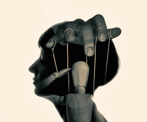 Marionette in woman head, black and white. Concept of mind control. Image