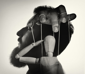 Marionette in male head, black and white. Concept of mind control. Image