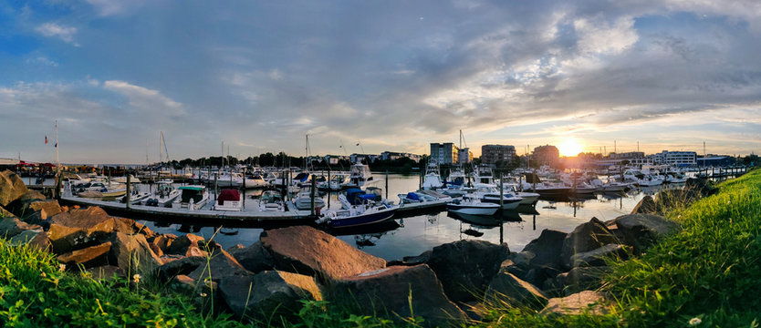 Golden hour sunset over harbor - panorama view of Harbor View, Stamford City, Connecticut