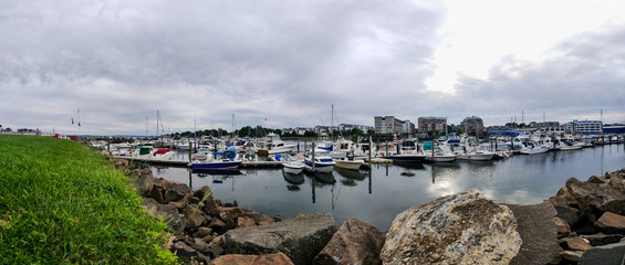 Rocky pier on a cloudy day - Panorama view of Harbor View, Stamford City, Connecticut