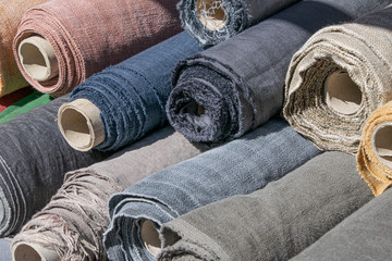 Rolls of linen canvas textile on market stall Wall mural