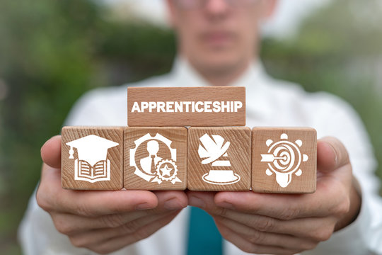 Apprenticeship on wooden blocks as education or job training concept.