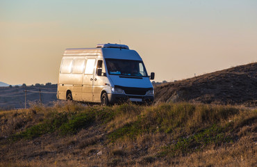 minibus moves to the hills on the road