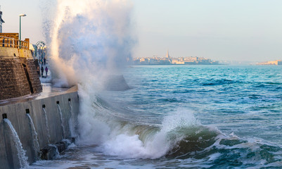 Big wave crushing during high tide in Saint-Malo