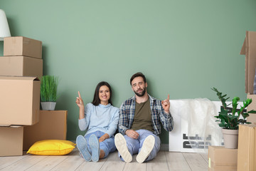 Young couple with cardboard boxes after moving into new house