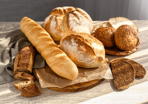 Assortment of fresh bread on table