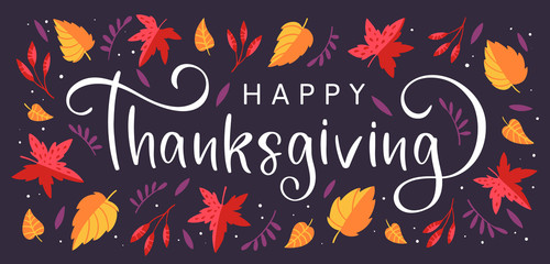 Background with colorful autumn leaves and hand drawn lettering Happy Thanksgiving