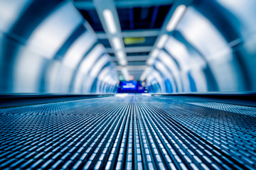 blurred motion of airport moving walkway, blue toned. Wall mural