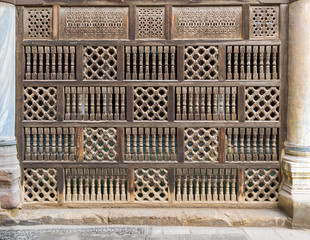 Front view of interleaved wooden arabisk wall - Mashrabiya, Facade of public historic mosque of Amir Al-Maridani, Cairo, Egypt