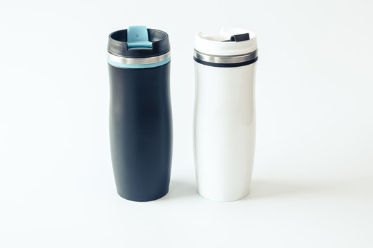 Isolated. Mockup. Black and white metal travel mugs with a place for your design. Close up.