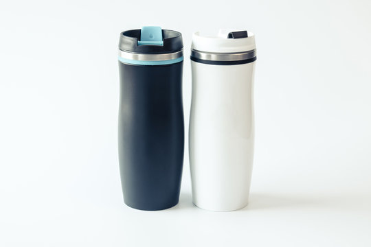 Black and white metal travel mugs with a place for your design. Isolated. Mockup. Close up.