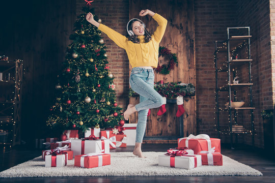 Full length body size photo of charming cute nice girl inspired with christmas music while dancing on carpet floor