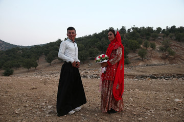 Sahar and Zal Shahbazi, Iranian nomad bride and groom, pose for a photo during their traditional wedding at Bazoft town in Chaharmahal and Bakhtiari Province
