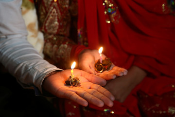 Sahar and Zal Shahbazi, Iranian nomad bride and groom, hold their wedding rings during their traditional wedding at Bazoft town in Chaharmahal and Bakhtiari Province