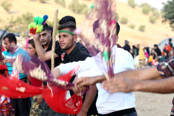 Invitees dance during the traditional wedding of Sahar and Zal Sahbazi, Iranian nomad bride and groom, at Bazoft town in Chaharmahal and Bakhtiari Province