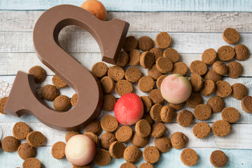 Chocolate letter, marzipan and spiced cookies (kruidnoten), food for Dutch December event, Sinterklaas