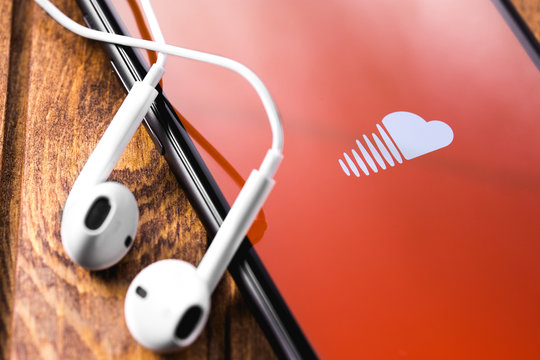 Soundcloud symbol on the screen Apple iPhone with Earpods. SoundCloud is a global online audio distribution platform. Moscow, Russia - March 15, 2019