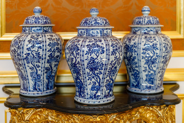 Three Chinese Porcelain Vases on shelf