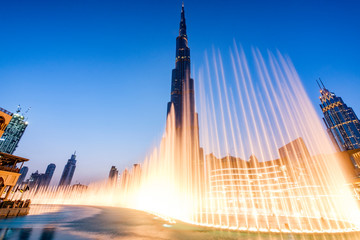 Fountains in Dubai mall overlooking Dubai cityscape and buildings