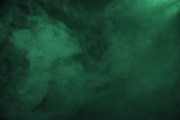 Green smoke on the dark background Wall mural