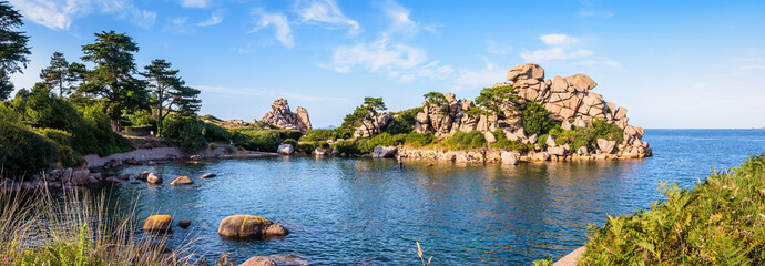 Panoramic view of the Pors Rolland creek on the Pink Granite Coast in northern Brittany, France, an idyllic rocky beach in the pink granite blockfield of Ploumanac'h. Wall mural