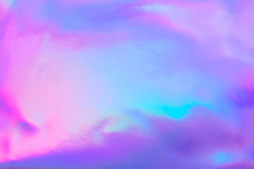 Wall Mural - Abstract trendy holographic background in 80s style. Blurred texture in violet, pink and mint colors with scratches and irregularities. Pastel colors.
