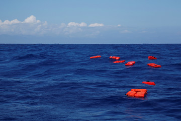 Life jackets float on the water during a training exercise by the German NGO Sea-Eye migrant rescue ship 'Alan Kurdi' while on its way to the search and rescue zone off the North African coast, in the western Mediterranean Sea