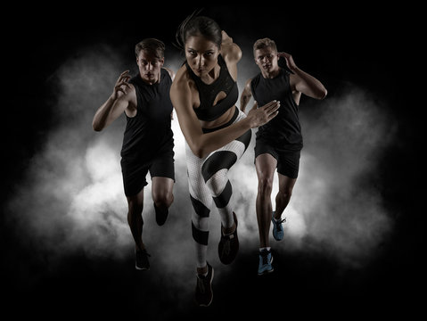 Sporty young woman and men running