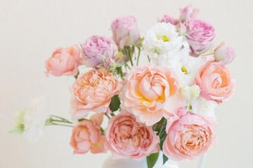 beautiful roses in ceramic white jug