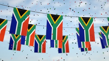 South African flags in the sky with confetti.