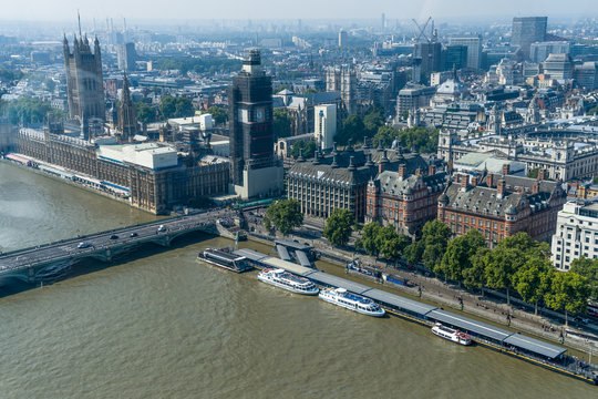 Aerial view of London with Westminster Bridge, Palace of Westminster and Big Ben being renovated in the distance.