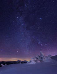 Fotobehang Aubergine Night starry sky in winter mountains
