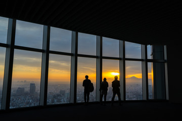 Silhouette of tourism looking a mtfuji from building in tokyo