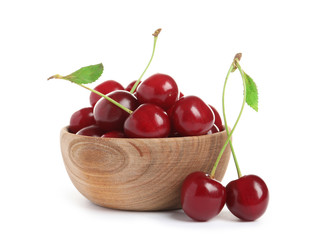Wooden bowl of delicious ripe sweet cherries on white background