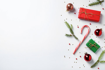 Fotobehang - Flat lay composition with Christmas gifts and festive decor on white background. Space for text