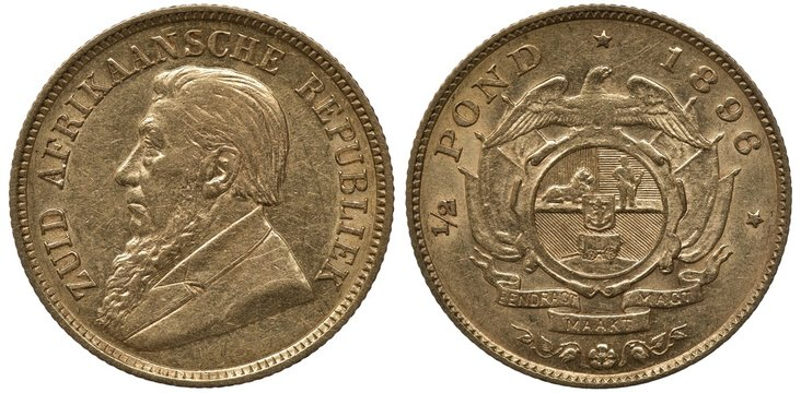 South African Republic Transvaal golden coin 1/2 half pound 1896, bust of President Krueger left, shield with lion, man and cart in front of crossed flags, eagle on top, ribbon with motto below,