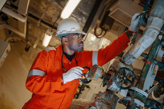 Man on board FPSO changing valve