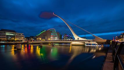 Samuel Becket Bridge at night in Dublin Ireland. Beautiful architecture and illuminated modern hotels