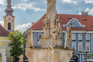 Close-up Detail of the Statue of Holy Trinity in Union Square in Timisoara, Romania with the Roman Catholic Cathedral in Background