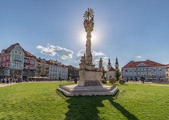 Panoramic View of Union Square in Timisoara and Statue of Holy Trinity backlit from the sun