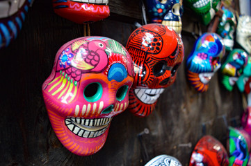 Many hand-painted, brightly-colored Dia de los Muertos skull souvenirs