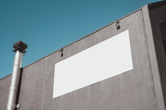 Wall with blank signage - empty banner ready for your artwork