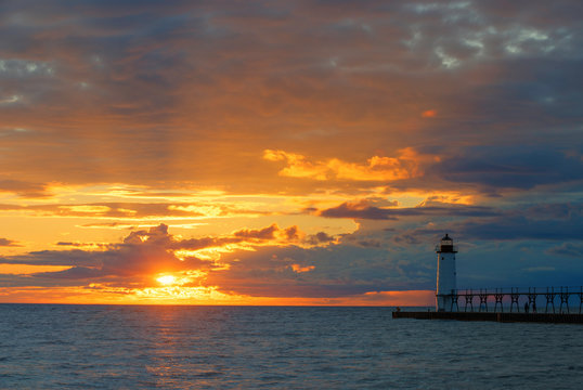Sunset over Lake Michigan at the Manistee North Pier Light